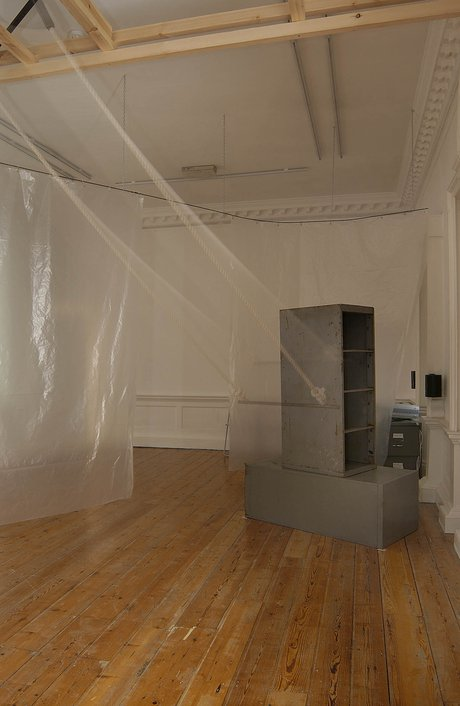Emma Woffenden: Locked Rooms. No Horizon, part 3, 2004. The trapeze is positioned in an upstairs back room and its sound can be heard throughout the building.