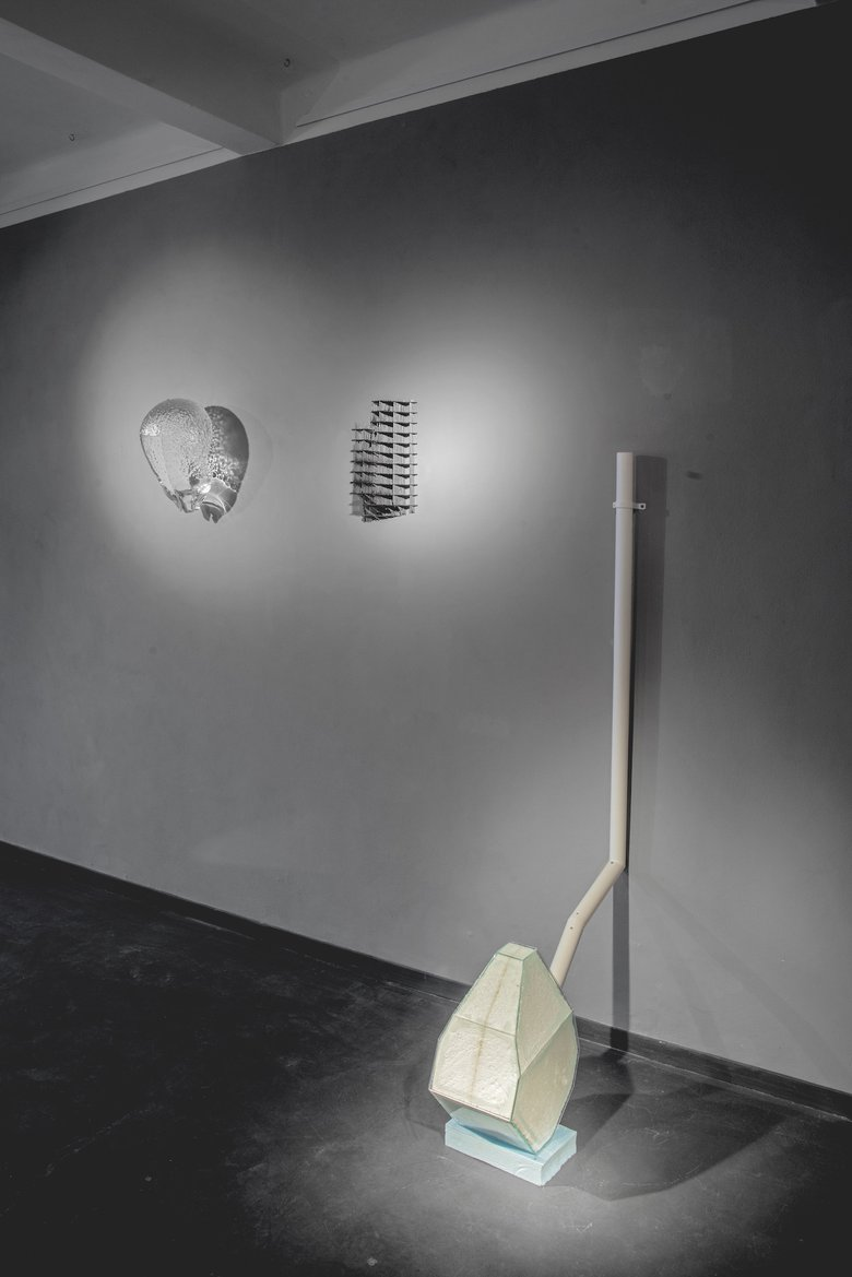 Emma Woffenden: Contact Isolation, 2019. Drained sculpture in the fore ground, shows two works on the wall by Peter Stanicky.