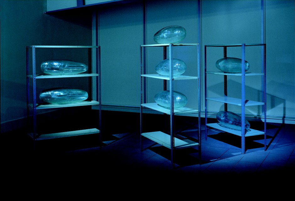 Emma Woffenden: Tableau, 1999. Storage Room. slumped glass and metal shelving. Installed at the National Glass Centre 1999