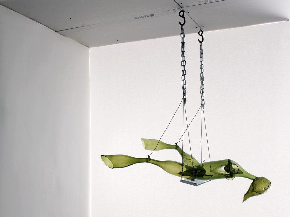 Emma Woffenden: Figurative work made from glass bottles, 2009. Shattered Swing Figure 110 × 100 × 50 cm Glass bottles, glass, metal fixings