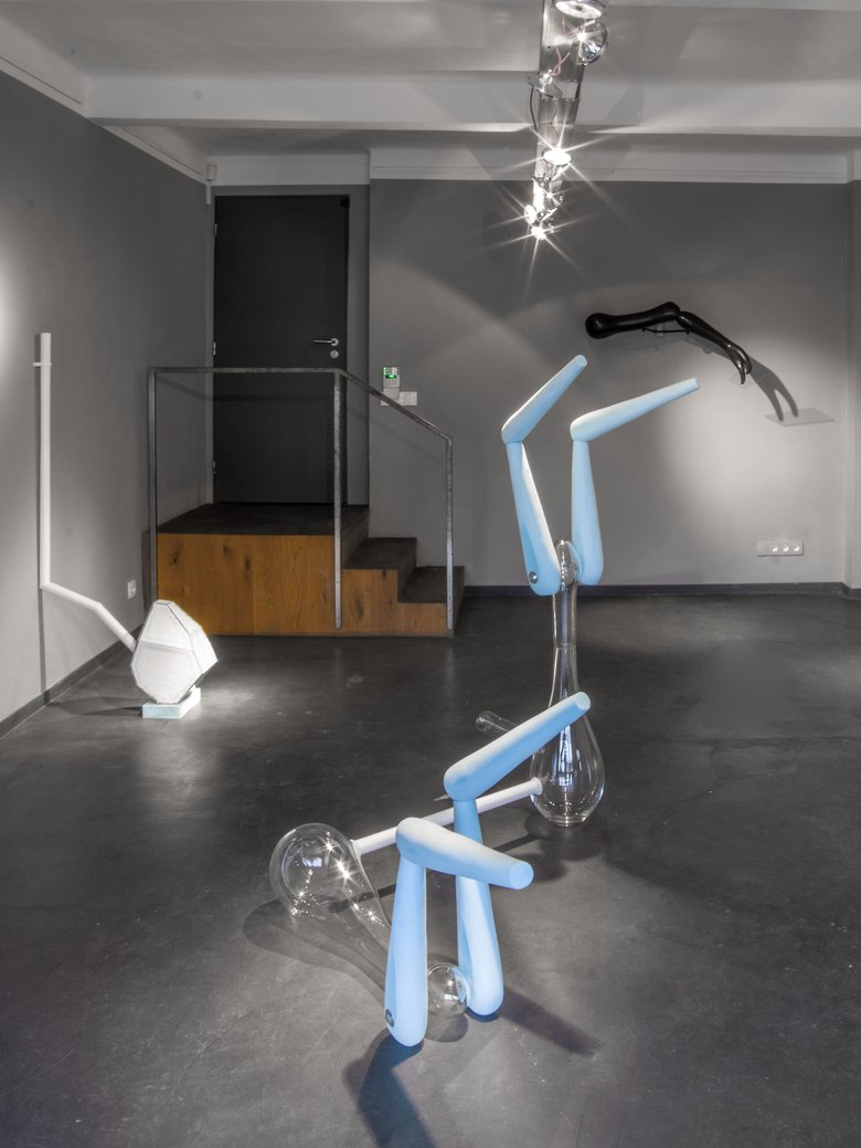 Emma Woffenden: Contact Isolation, 2019. Head over Heels, blown glass, plastic pipe and styrofoam.