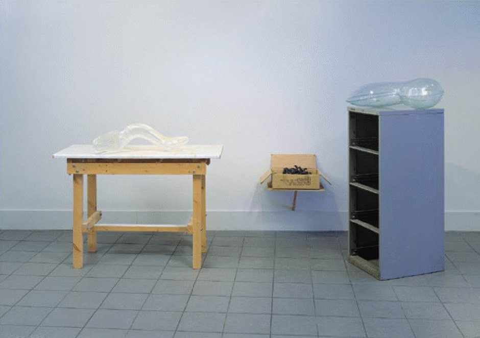Emma Woffenden: Tableau, 1999. Cast and slumped glass objects with found furniture. Wax Elements in cardboard box